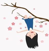 liten flicka som hänger på en körsbärsträdgren