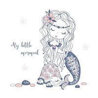 eine süße kleine Meerjungfrau mit einer Schildkröte.
