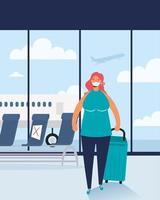 kvinna med ansiktsmask och resväska på flygplatsen