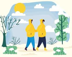 par med ansiktsmasker i ett vinterlandskap