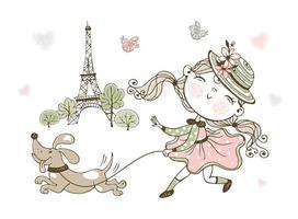 söt liten flicka som går sin hund i paris