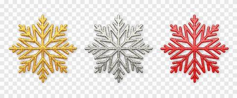 mousserande gyllene, silver och röda snöflingor