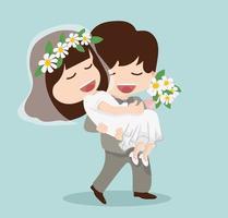 brudgummen håller bruden