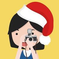 kleines Mädchen macht Foto mit Weihnachtsmütze vektor