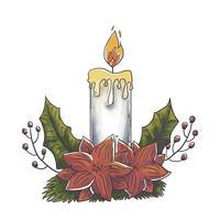 Söt julstearinljus med röda blommor och löv