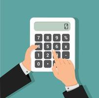 affärsman som använder en miniräknare