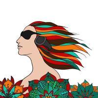 Frau hört Musik in Blumen