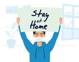 Mann hält ein Schild zu Hause bleiben