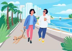 par med hund som går längs strandpromenaden
