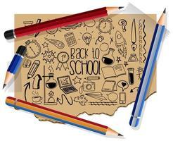 handgezeichnete Schulelemente auf Papier mit vielen Stiften