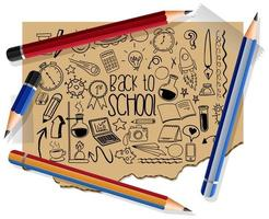 handritade skolelement på papper med många pennor