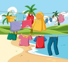 många kläder hänger på en linje i strandscenen