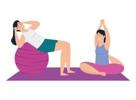 Frauen, die zusammen Yoga und Pilates machen