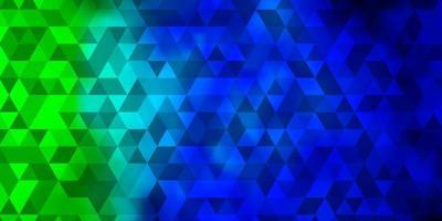 hellblauer, grüner Vektorhintergrund mit polygonalem Stil. vektor