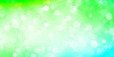 ljusgrön vektormall med cirklar. vektor