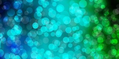 ljusblå, grön vektorlayout med cirkelformer. vektor