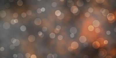 mörk orange vektor bakgrund med fläckar.