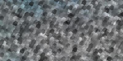 ljusblå vektorlayout med sexkantiga former. vektor