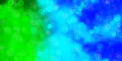 ljusblått, grönt vektormönster med cirklar.