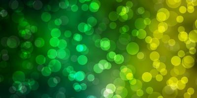 hellgrünes, gelbes Vektormuster mit Kreisen. vektor