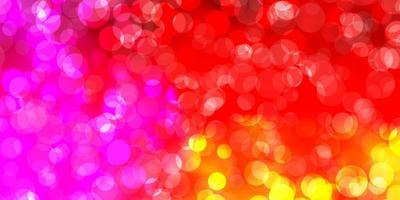 ljusrosa, gul vektorbakgrund med fläckar.