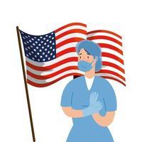hälsoarbetare med ansiktsmask och usa flagga