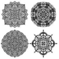 samling av fyra svartvita blommiga etniska mandalaer, på vit bakgrund