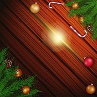 leere Weihnachtsschablone mit braunem hölzernem Hintergrund verziert mit Weihnachtsbaumzweigen, Zuckerstangen und Weihnachtskugeln, Draufsicht
