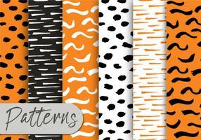Orange Black Brush-Muster-Set vektor