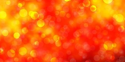 ljus orange vektor bakgrund med cirklar.