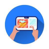 Tablet-Elektronik mit Einkaufskorb und Lebensmitteln
