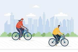 junges Paar Fahrrad fahren mit medizinischen Masken