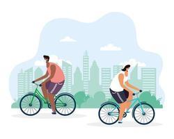 junge Männer, die Fahrrad fahren und medizinische Maske tragen