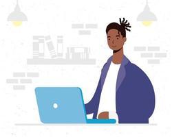 afrikansk man som använder bärbar datortecken