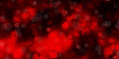 mörk röd vektor bakgrund med fläckar.
