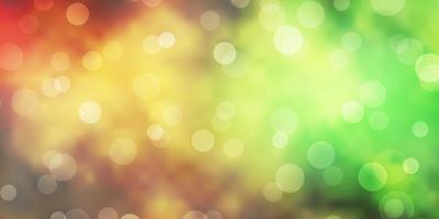 ljusgrön, gul vektorbakgrund med cirklar.