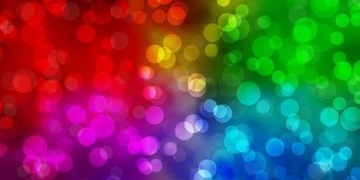 ljus flerfärgad vektor bakgrund med cirklar.