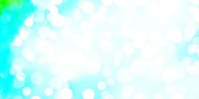ljusblå, grön vektorbakgrund med prickar.