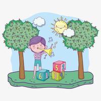 glücklicher Kindertag, Junge, der mit musikalischer Trompete im Park spielt
