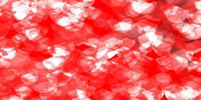 ljusröd vektorbakgrund med fläckar.