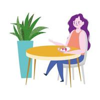 Restaurant soziale Distanzierung, Frau isst Obst allein am Tisch, Prävention Covid 19 Coronavirus
