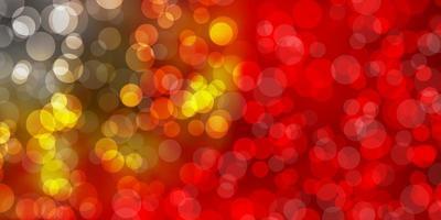 ljusröd, gul vektorbakgrund med fläckar.