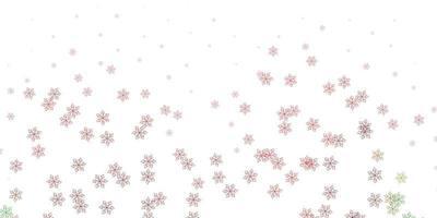 ljusgrön, röd vektor doodle mönster med blommor.
