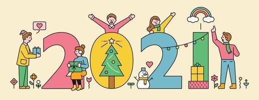 människor dekorerar ett enormt 2021-nummer.