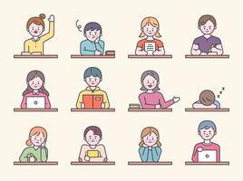 studenter som sitter vid skrivbord i skolklassen.