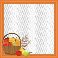 Rahmen mit Herbstfrüchten im Weidenkorb