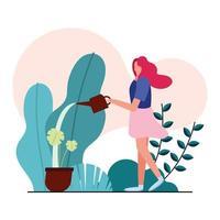 junge Frau, die sich um Pflanzen im Garten kümmert