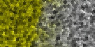 ljus gul vektor bakgrund med hexagoner.