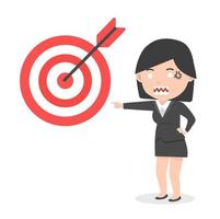 arg affärskvinna som pekar på ett mål