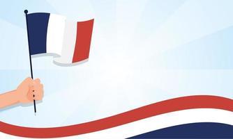 Hand, die Frankreich-Flagge für glücklichen Bastille-Tagesvektorentwurf hält